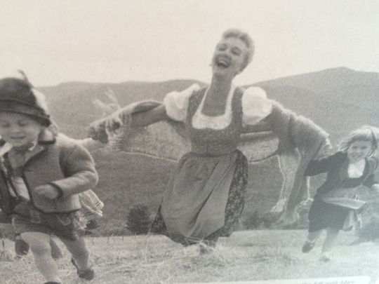 "A photo from the CD booklet for ""Something Good: Songs of Rodgers & Hammerstein"" shows Broadway star Mary Martin and 5-year-old Elisabeth von Trapp (right) running in a field in Stowe. (Photo: COURTESY)"